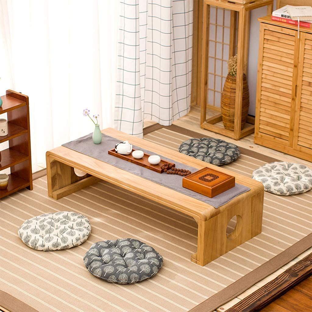 Bàn trà thấp chất liệu gỗ là món nội thất đặc trưng trong thiết kế phòng khách kiểu Nhật