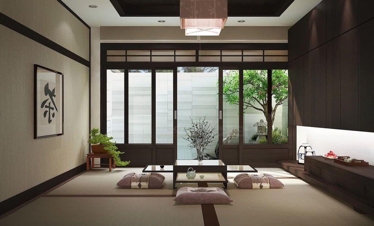 Mẫu phòng khách đặc trưng với bộ bàn trà và nệm ngồi nhưng cách phối màu vô cùng hiện đại, trang trọng