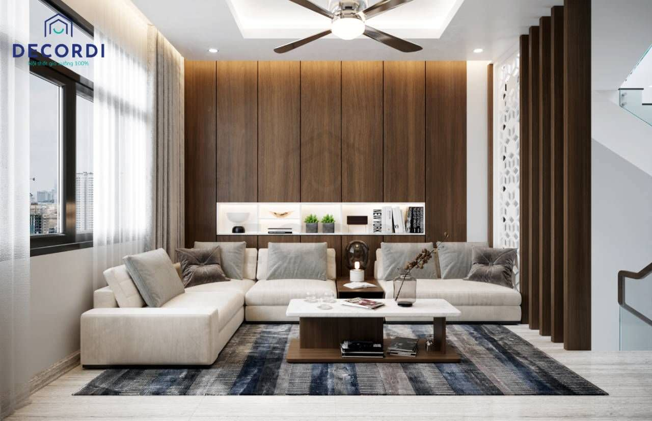 Bộ sofa nỉ chân thấp mang đến cảm giác trần nhà cao và rộng hơn cho phòng khách nhỏ thông tầng