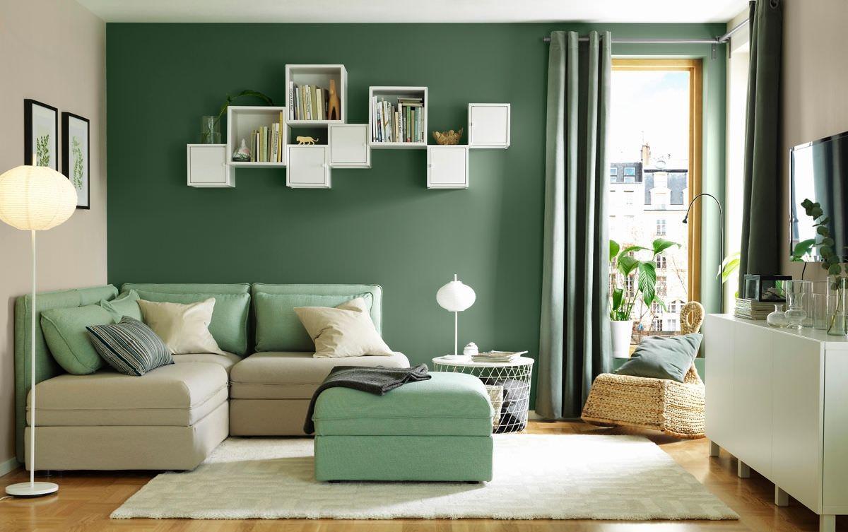 Thiết kế phòng khách 12m2 hình vuông hiện đại với gam màu xanh rêu nhẹ nhàng