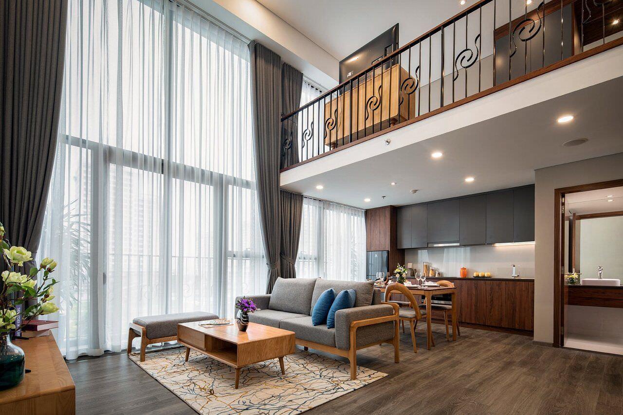 Phòng khách thông tầng hiện đại dạng căn hộ penstudio tiện ích